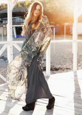 woman in bright maxi dress