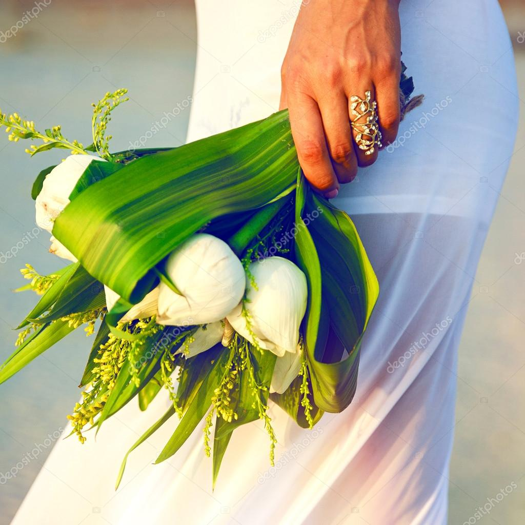 Woman with exotic wedding lotus bouquet stock photo bride woman holding exotic wedding lotus bouquet sunny bright colors photo by annharitonenko dhlflorist Images