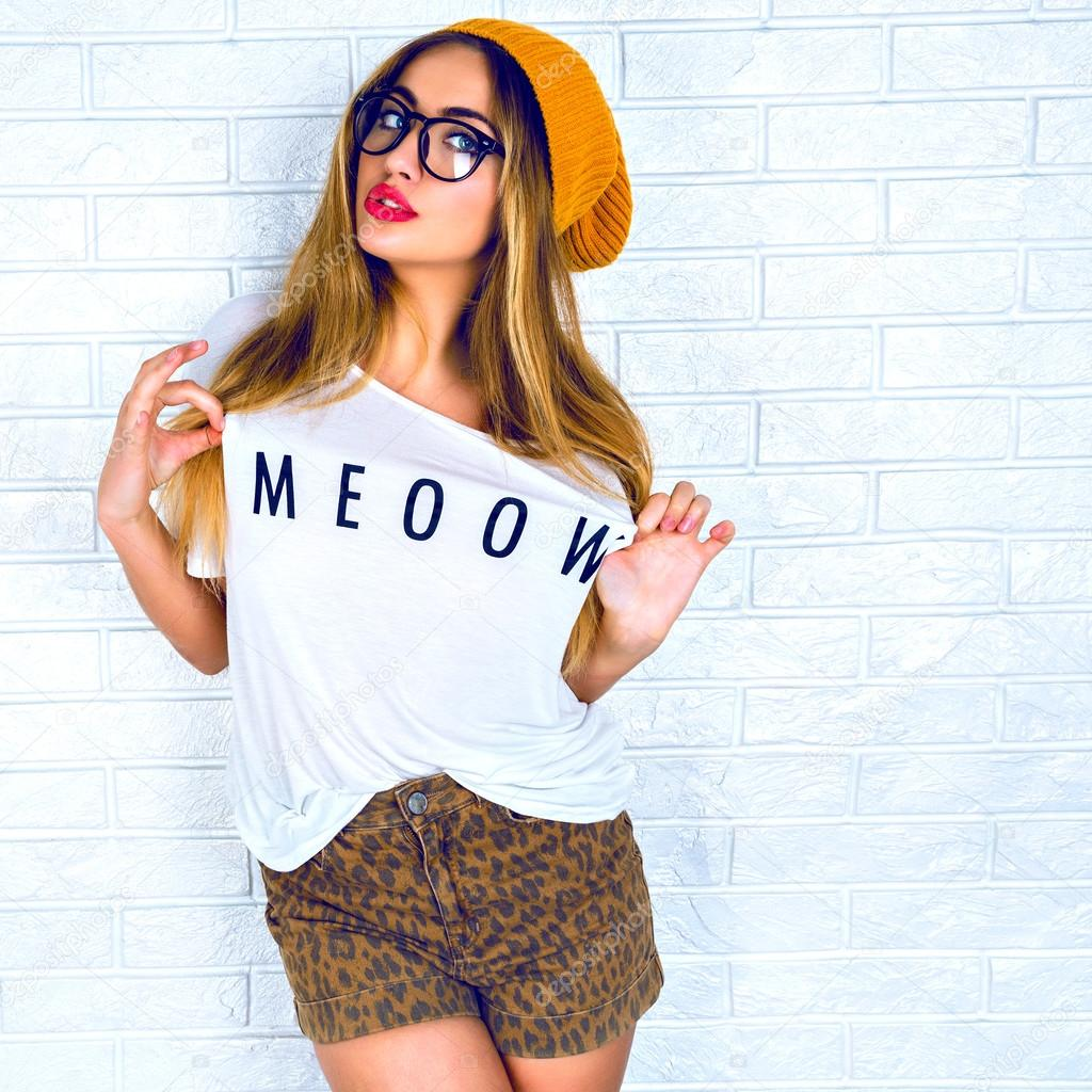 stylish hipster girl in glasses and hat