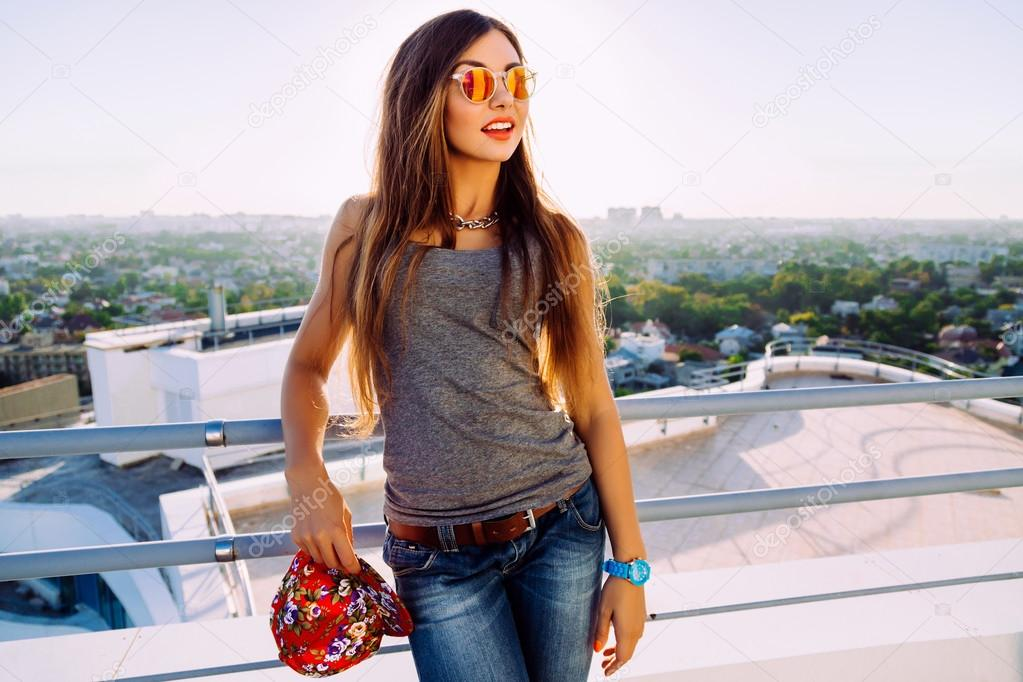 Stylish girl posing at the roof