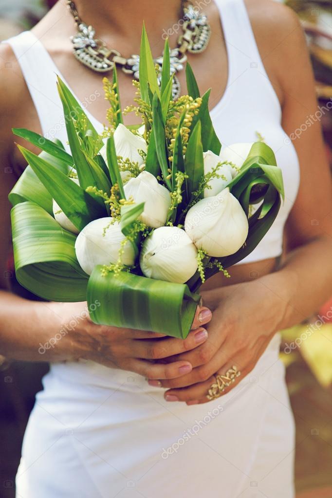 Bride Holding Exotic Lotus Wedding Bouquet Stock Photo