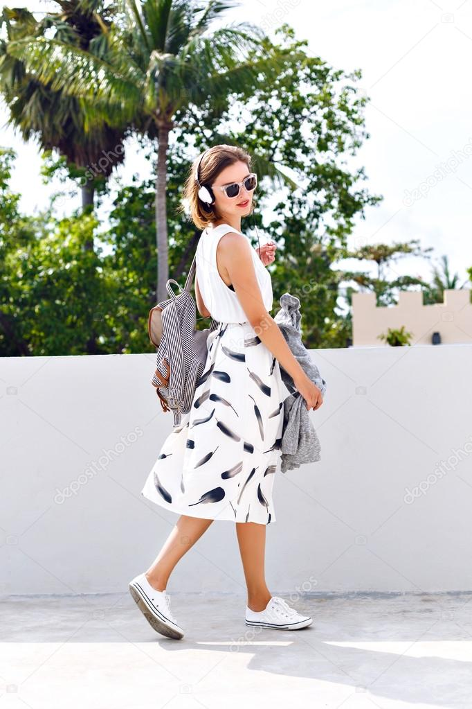 Woman wearing backpack and sunglasses