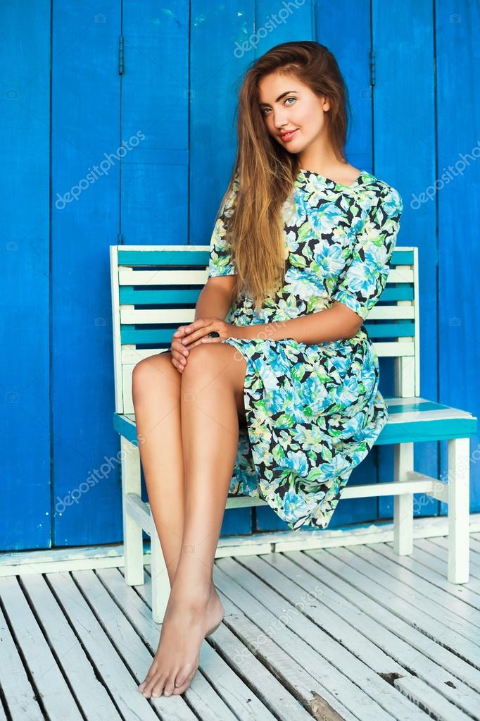 Blonde tan woman posing outdoor