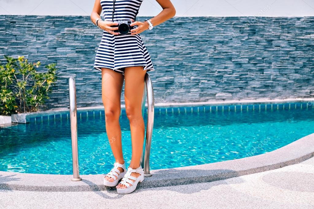woman in high heeled shoes near pool