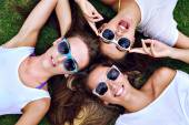 Young hipsters student girls in sunglasses