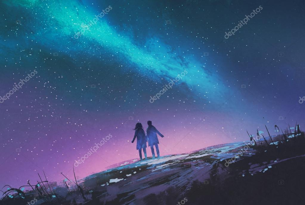 Young couple standing holding hands against the Milky Way galaxy