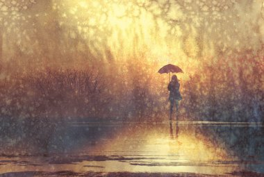 lonely woman with umbrella in lake