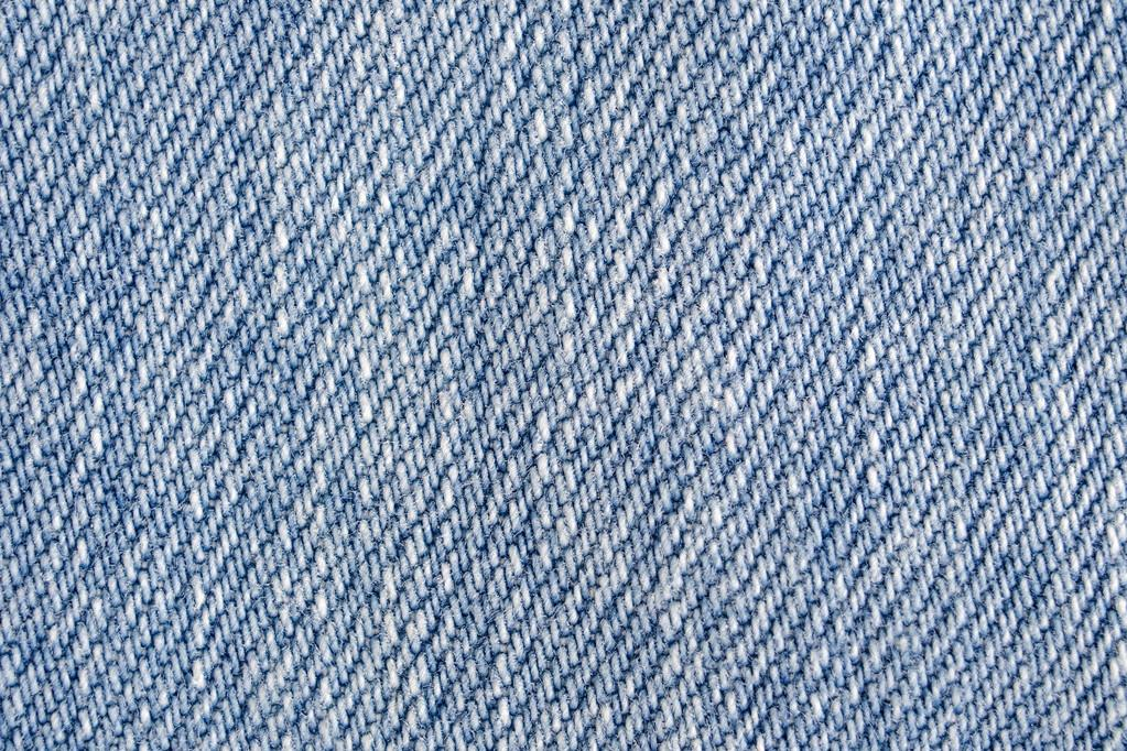jeans background light blue denim fabric texture close up