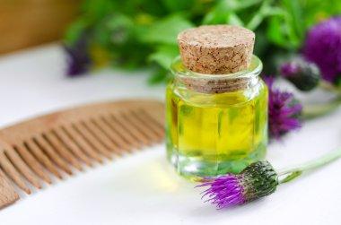Small bottle of burdock oil