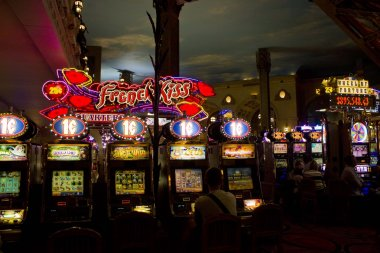 Inside the Paris Casino in Las Vegas, view of the slot machines at night