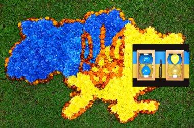 Map of Ukraine (contours), coat of arms Ukraine (trident) in blu
