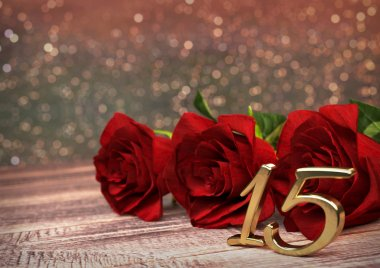 birthday concept with red roses on wooden desk. fifteenth. 15th. 3D render