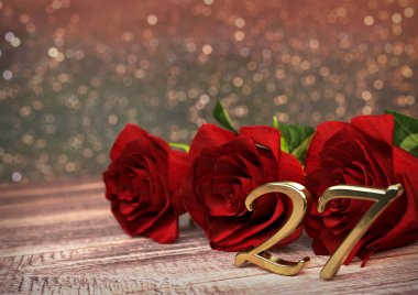 birthday concept with red roses on wooden desk. twenty-seventh. 27th. 3D render