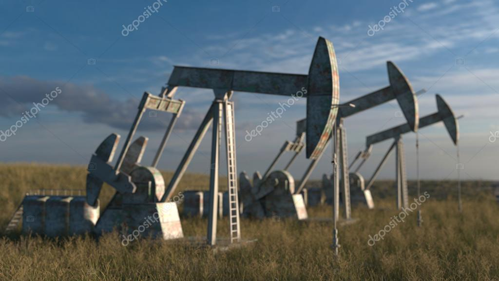 Oil wells - oil pumps on sky background