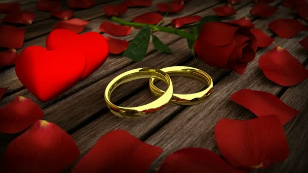 dva zlaté snubní prsteny a červené růže s lístky