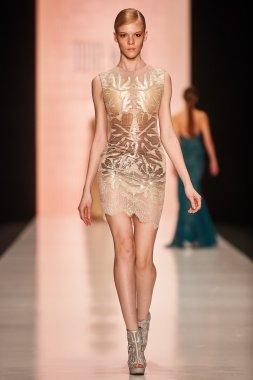 A model walks on the Tony Ward catwalk