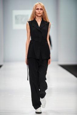 A model walks on the NATASHA DRIGANT catwalk