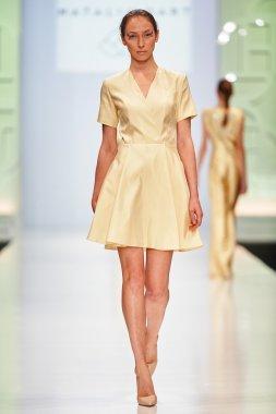 A model walks on the NATALIA GART catwalk