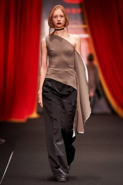 A model walks on the BESSARION catwalk