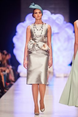 A model walks on the IGOR GULYAEV catwalk