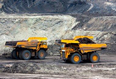Big yellow mining truck at work sit