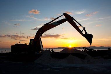 Excavator machine doing earthmoving