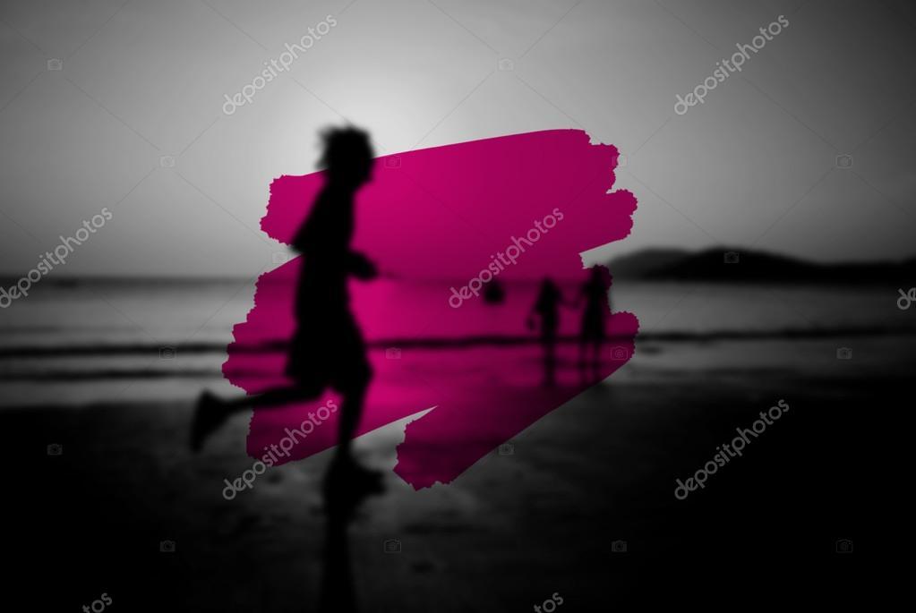 man jogging on beach at sunset