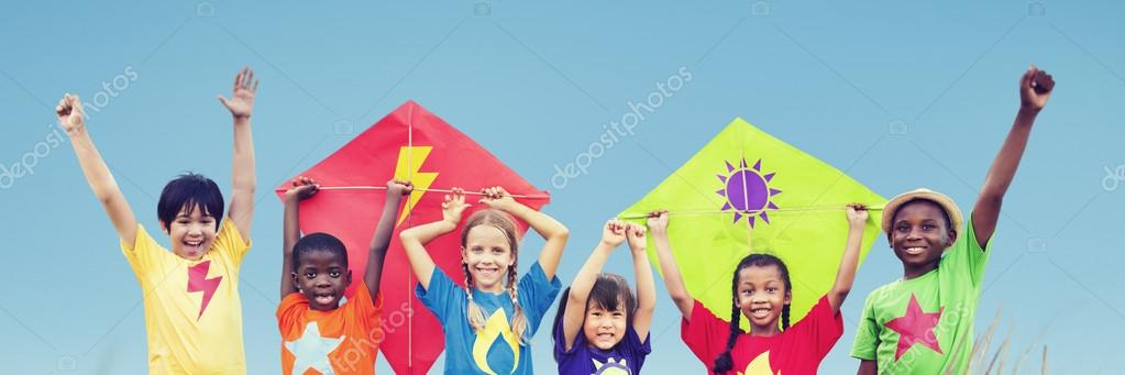 Kids Playing on Beach with kite