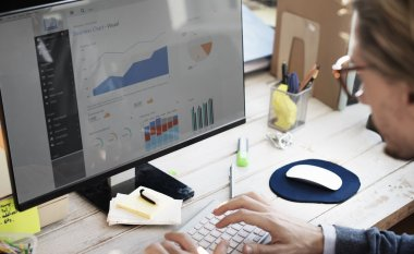 Businessman analyzes on Computer