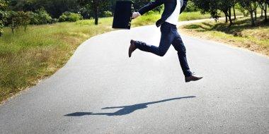 Businessman at outdoors jumping