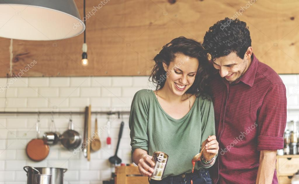 happy couple cooking together