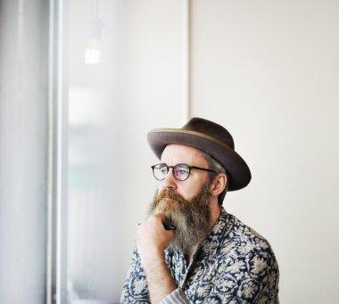 Stylish hipster man thinking about something
