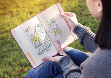 woman reading book and plan
