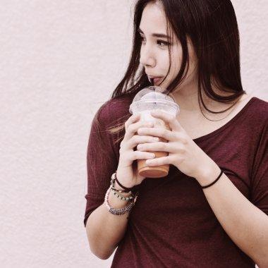 Woman Drinking Beverage