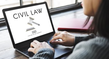 woman typing on laptop with Civil Law