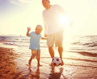 father and son playing with ball