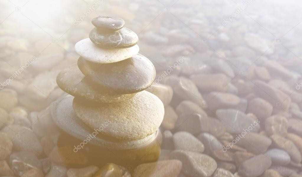 Balancing Pebbles Covered with Water