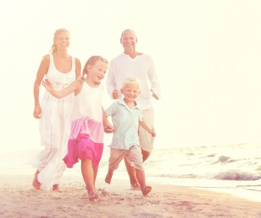 Happy Family with kids at beach