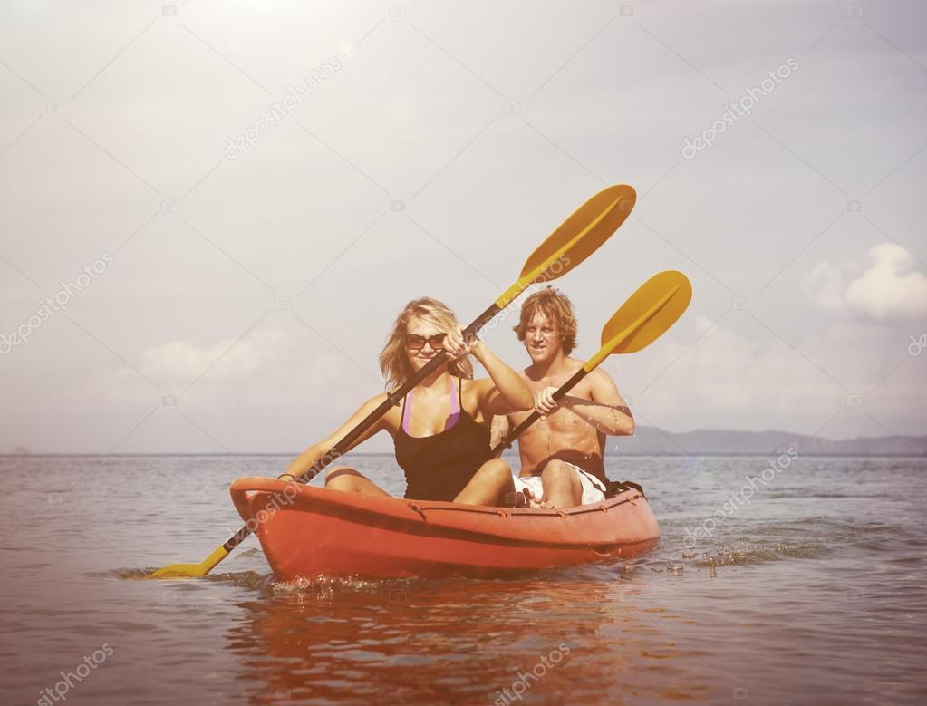 Couple Kayaking on beach