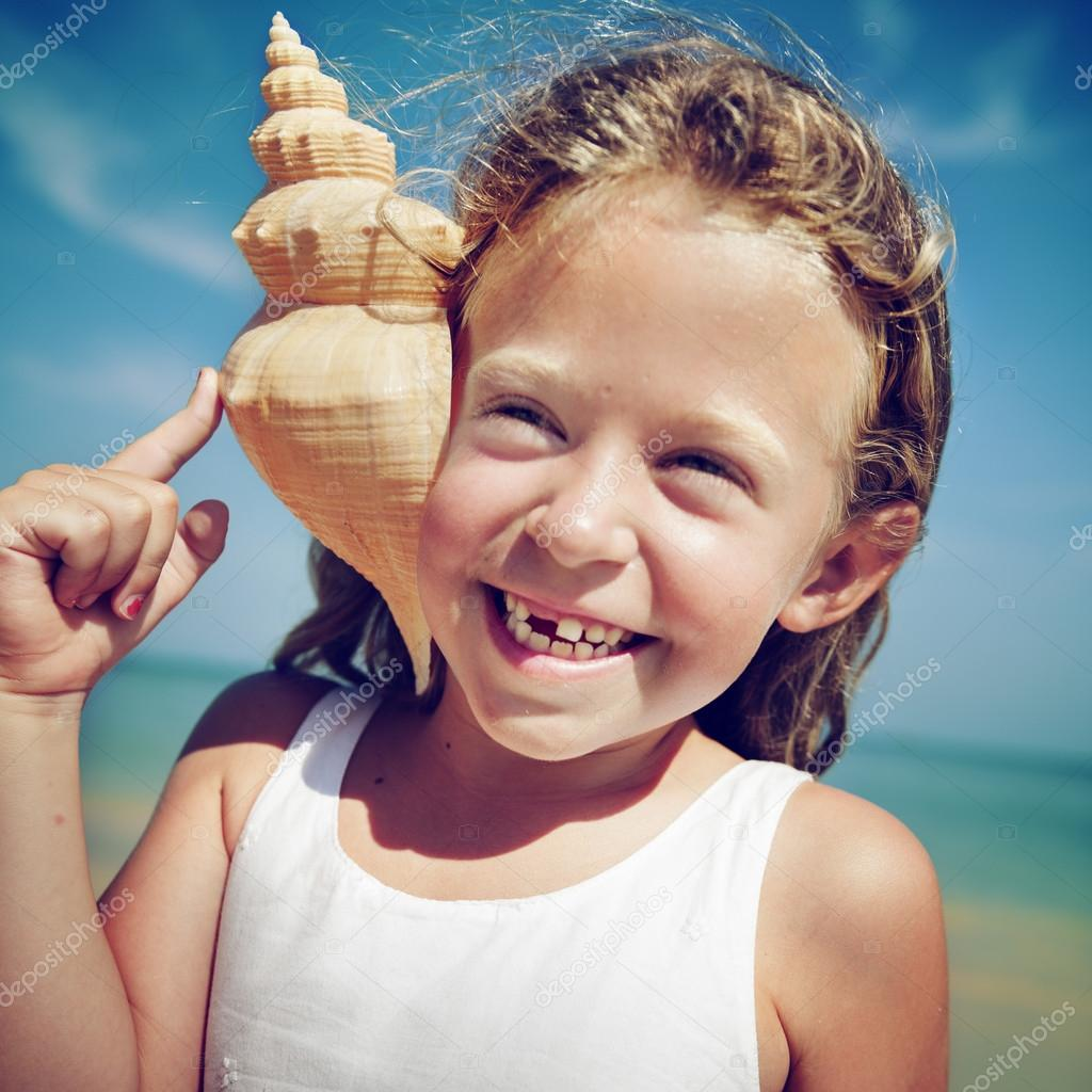 Little Girl Cheerful on Beach