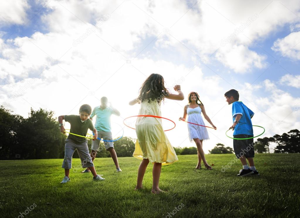 family doing exercise with hula hoops