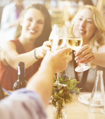 Happy women Toasting with wine at the restaurant