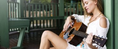 Hippie Girl with Guitar outdoors