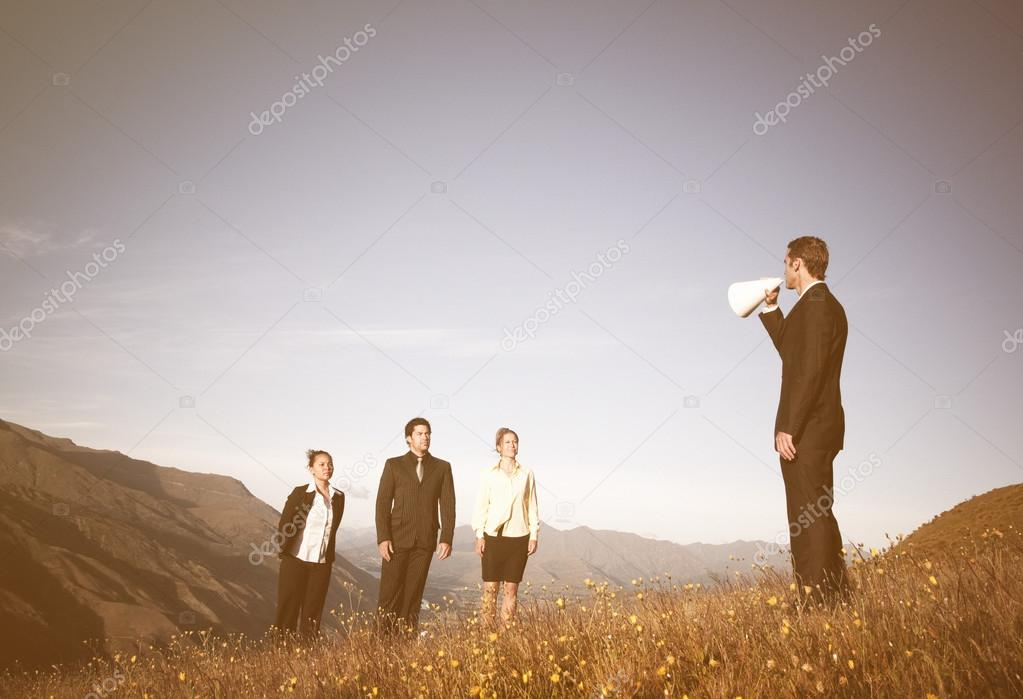 Business people in mountains