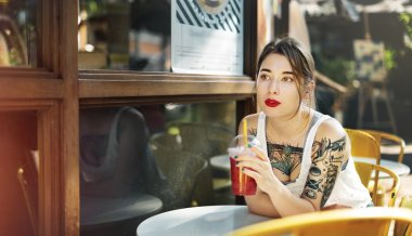 Woman Drinking beverage in cafe