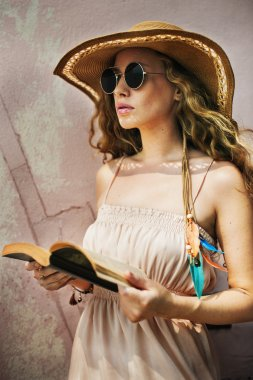 Woman in Sunglasses Reading Book