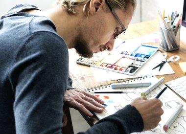 man  Drawing in  Design Studio
