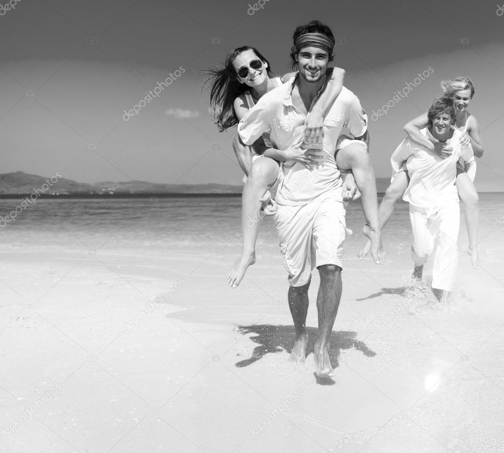 Two couples relaxing on beach