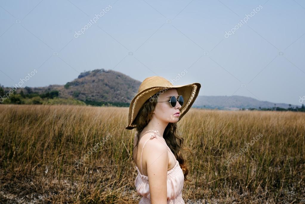 Summer girl walking on Grassland