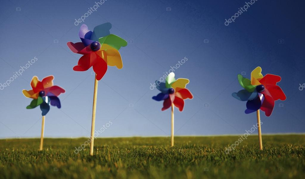 Colorful pinwheels on grass